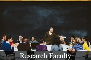 Research Faculty image showing a class facing a teacher in front of a large chalkboard.