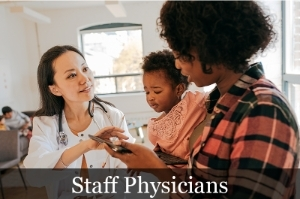 Staff Physicians image showing a physician with patients.