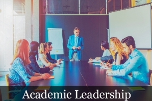 Academic Leadership image showing a teacher at the head of a conference table with students.